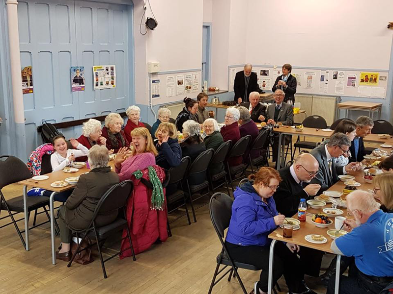 People having soup at St Michael's Sunday Soup