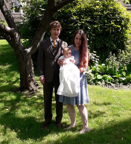 Baptism baby with child under a tree at St Michael's Church
